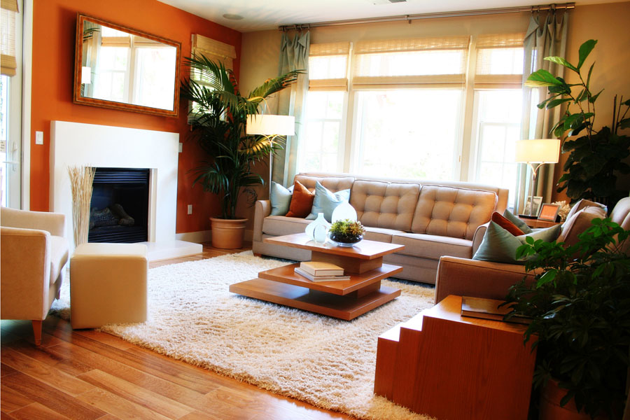 Mirror Tv Hung Above Fireplace On Orange Wall