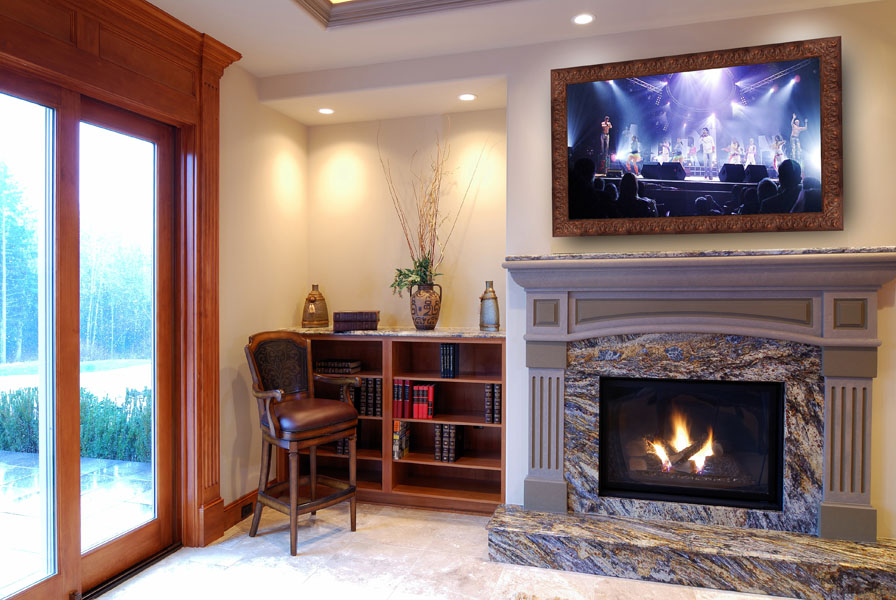 dielectric tv mirror above fireplace